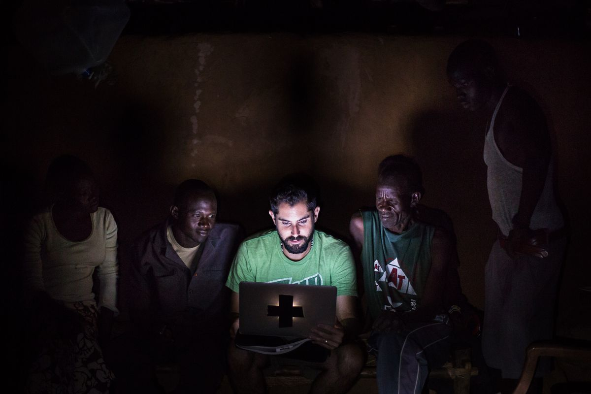 Ryan Boyette (center) shares a Nuba Reports video