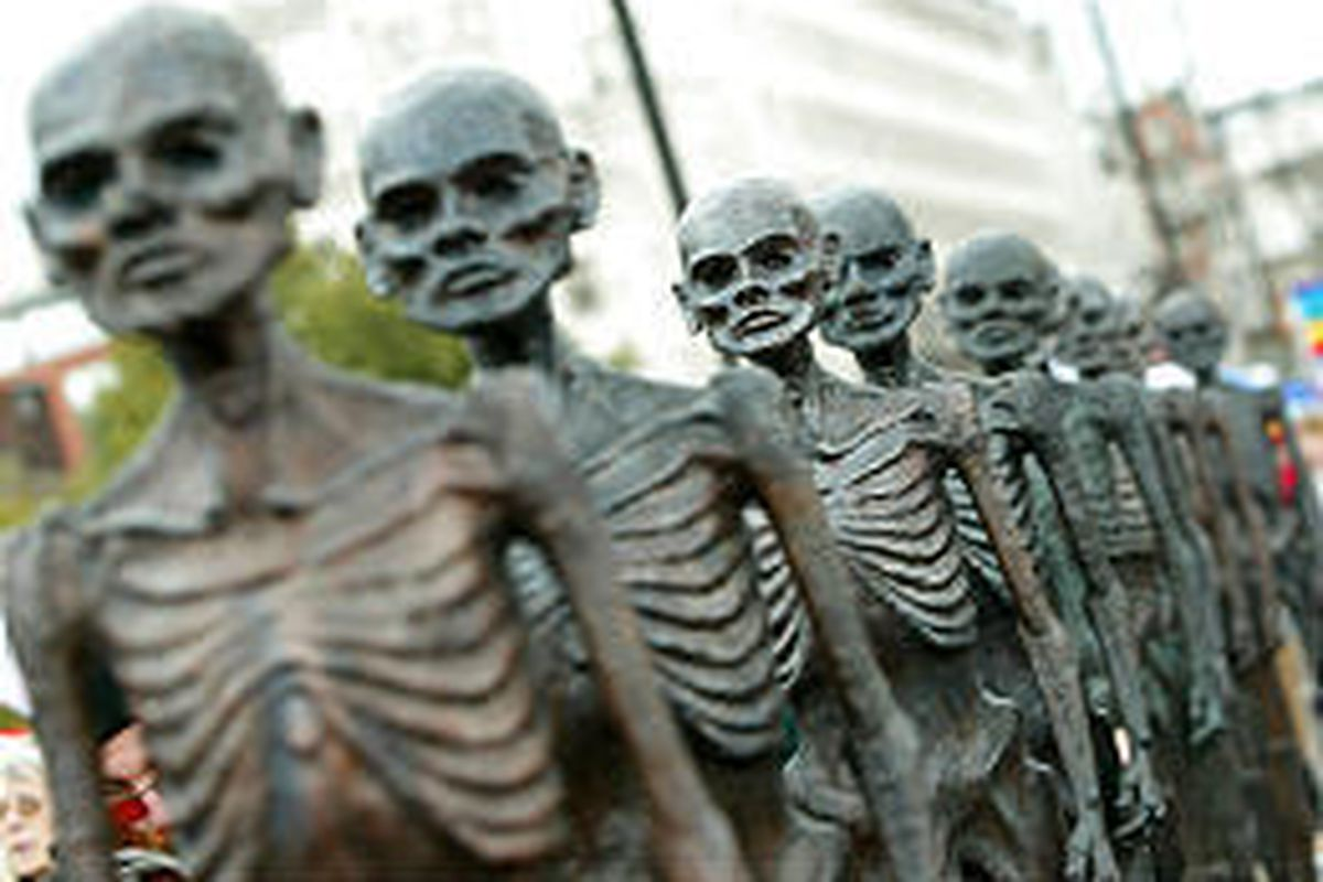 Skeleton sculptures were part of an anti-war march in London Sunday. Around 75,000 Britons participated.