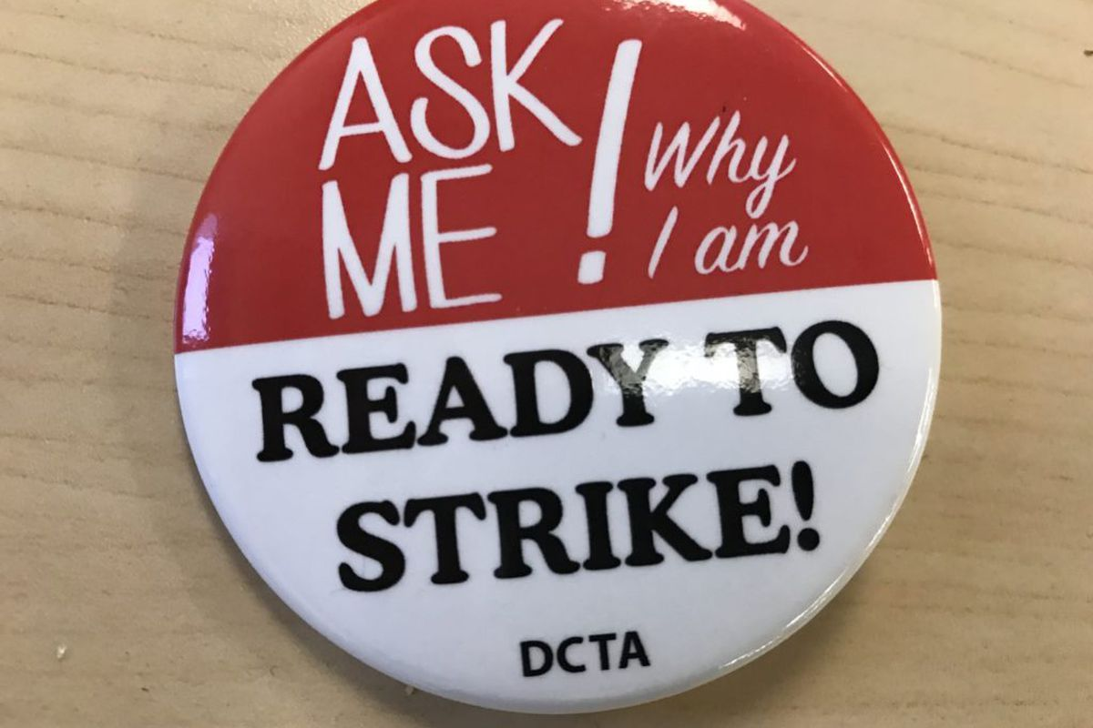 Some Denver teachers are wearing these buttons, provided by the union, at the teacher pay negotiations.