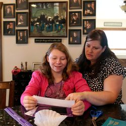Sarah Simmons and her mom Amy Simmons go over stuff for the new school year at their home in Kamas on Saturday, Aug. 24, 2013. Sarah was adopted from Russia with three of her biological siblings.