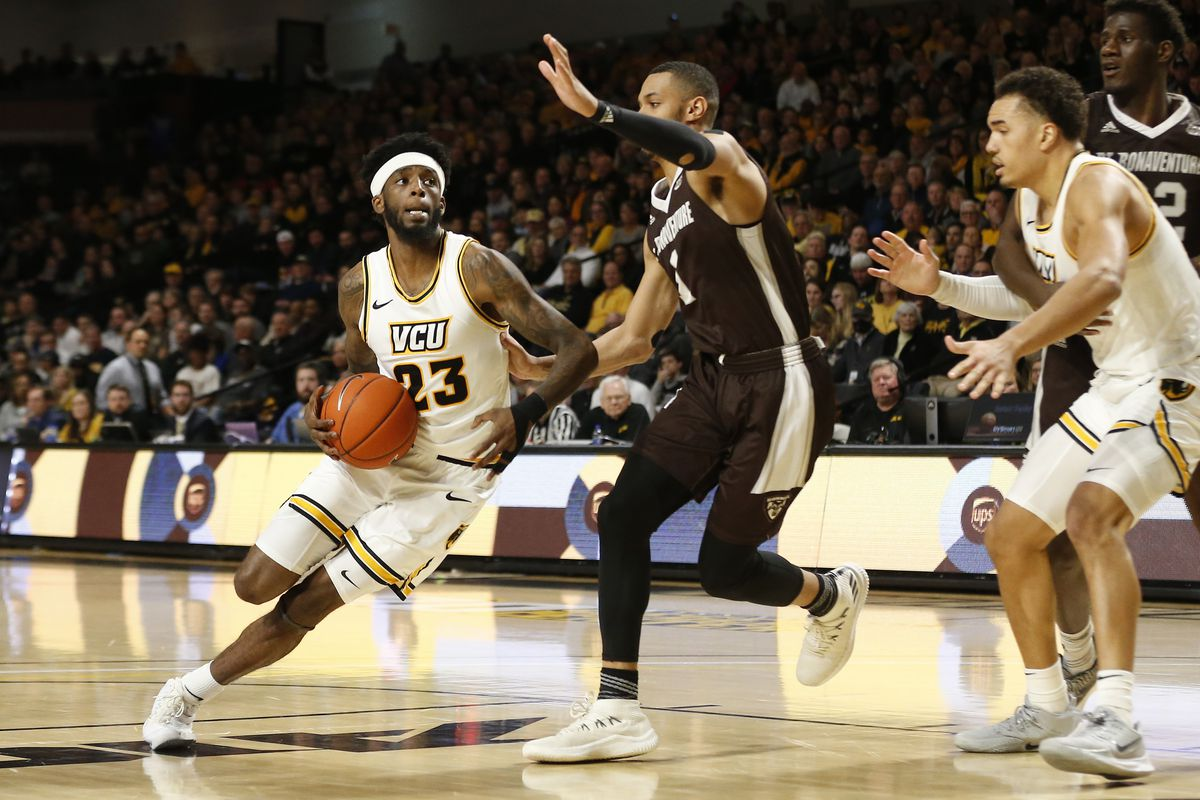 Virginia Commonwealth Rams forward Issac Vann drives to the basket as St. Bonaventure Bonnies guard Dominick Welch defends in the second half at Stuart C. Siegel Center.