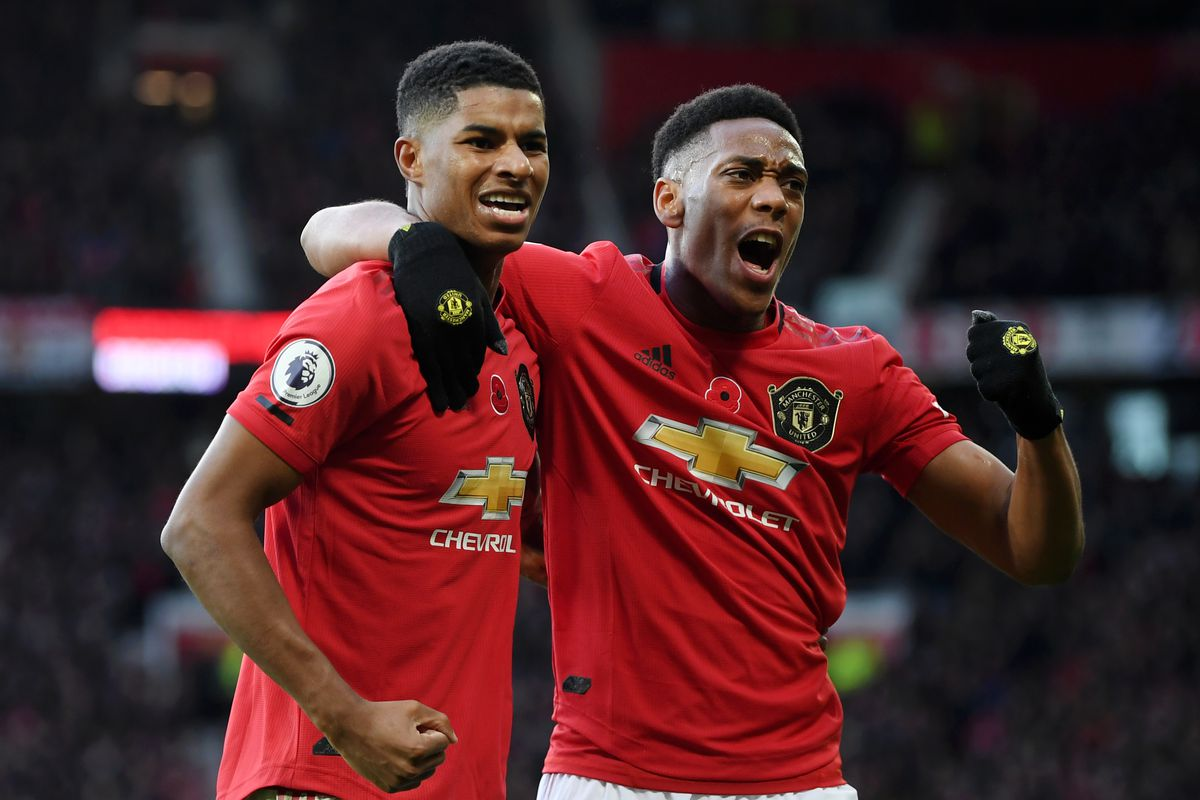 Marcus Rashford celebrates with teammate Anthony Martial - Manchester United - Premier League