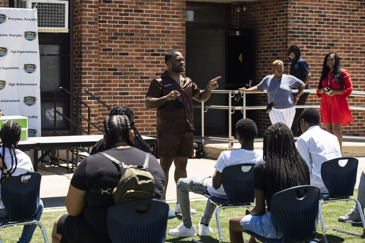 Dion Dawson, president and CEO of Dion's Chicago Dream, presents the non-profit's first-annual Dream Star Capsule to the 2021 8th-grade graduates at Jensen Miller Scholastic Academy at 3030 W. Harrison St. on the West Side on Monday.