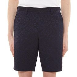 """<strong>Fred Perry</strong> Panther Pattern Slim Fit Shorts in Navy, <a href=""""http://www.fredperry.us/panther-pattern-slim-fit-shorts-ss4251.html"""">$225</a>"""