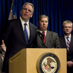 Peter Neronha, center, U.S. attorney for the district of Rhode Island, announces the arrest of alleged New England mafia boss Anthony DiNunzio, during a news conference, in Providence, R.I., Wednesday, April 25, 2012, as James Trusty, chief of the organized crime and gang section in the U.S. Justice Department Criminal Division, center, and Richard Deslauriers, FBI special agent in charge of the Boston Field Office, right, look on.The investigation into the alleged shakedown of Providence strip clubs left the New England mafia without a leader on Wednesday as authorities arrested the reputed boss in Boston on charges he oversaw the mob's extortion of adult entertainment businesses and sought to broaden its influence.
