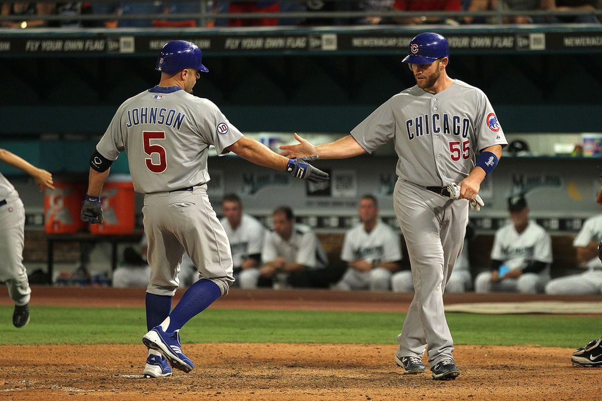 Reed Johnson of the Chicago Cubs is congratulated by Koyie Hill after hitting a two-run home run during a game against the Florida Marlins at Sun Life Stadium on May 18, 2011 in Miami Gardens, Florida.  (Photo by Mike Ehrmann/Getty Images)