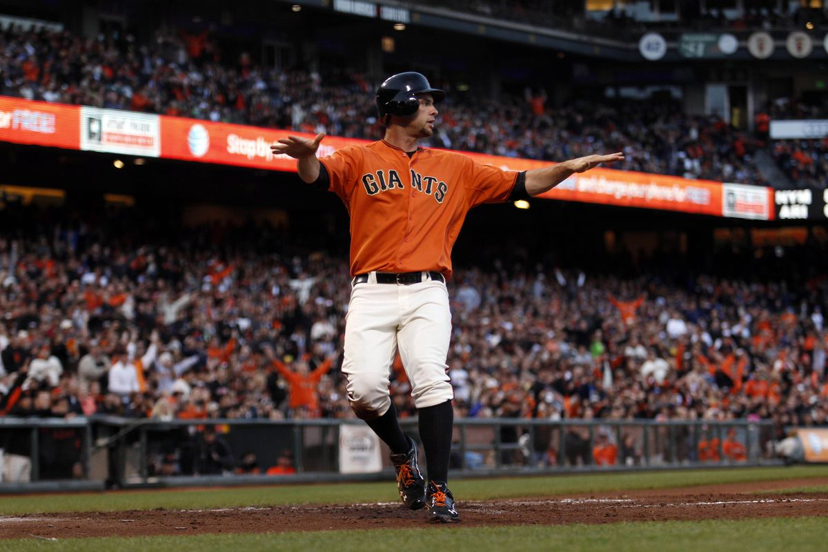 July 27, 2012; San Francisco, CA, USA; San Francisco Giants first baseman Brandon Belt crosses home plate to score a run during the second inning against the Los Angeles Dodgers at AT&T Park. Mandatory Credit: Beck Diefenbach-US PRESSWIRE