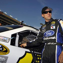 Matt Kenseth smiles after getting out of his car during qualifying for Sunday's NASCAR Sprint Cup Series auto race at Atlanta Motor Speedway, Friday, Aug. 31, 2012, in Hampton, Ga.