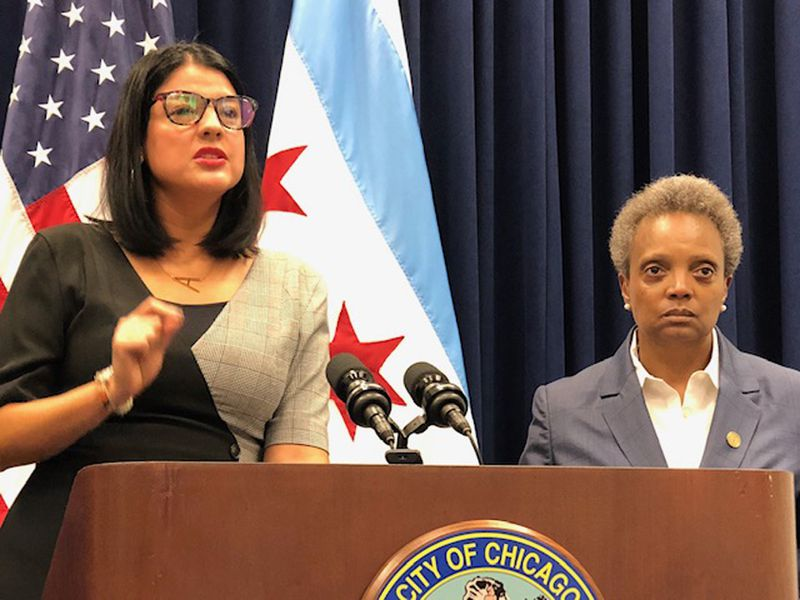 City Clerk Anna Valencia and Mayor Lori Lightfoot discuss changes in ticketing and penalties after a Chicago City Council meeting in 2019.