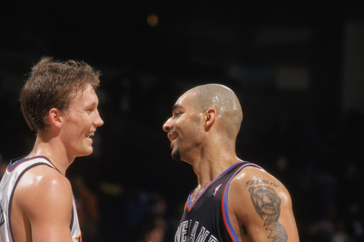 Boozer shakes hands with Dunleavy Jr