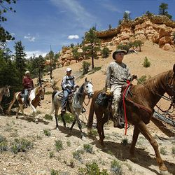 Russ Pack leads a group of horseback riders through spectacular scenery along the Butch Cassidy Trail in the Red Canyon area in Dixie National Forest on June 2.