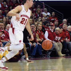Badger fans react to a no-foul call on the sideline at the end of the first half