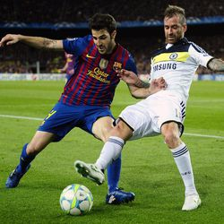 FC Barcelona's Cesc Fabregas, left, duels for the ball against Chelsea's Raul Meireles during a semifinal second leg Champions League soccer match at the Camp Nou stadium in Barcelona, Spain, Tuesday, April 24, 2012.