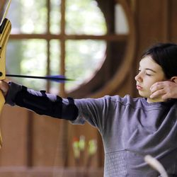 Ket Davis releases an arrow during an archery session at a Girl Scout day camp in Carnation, Wash., on Tuesday, June 26, 2018. | AP Photo