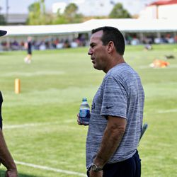 Former Broncos G Mark Schlereth (left) and former Broncos Head Coach and now Senior Personnel Advisor Gary Kubiak (right) have a chat at training camp.