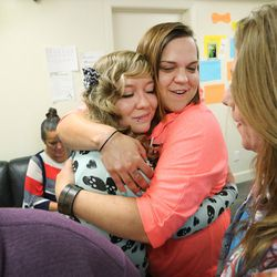 Intensive Supervision client Amanda Newsome, left, hugs Krise Harper, another client and friend, at Valleycore for Women in Salt Lake City on Thursday, Oct. 6, 2016.
