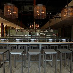 Pull a chair up to the full bar for drinks from Peter Vestinos