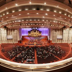 Attendees sing a congregational hymn during the Sunday morning session of the 191st Semiannual General Conference of The Church of Jesus Christ of Latter-day Saints in the Conference Center in Salt Lake City on Sunday, Oct. 3, 2021.