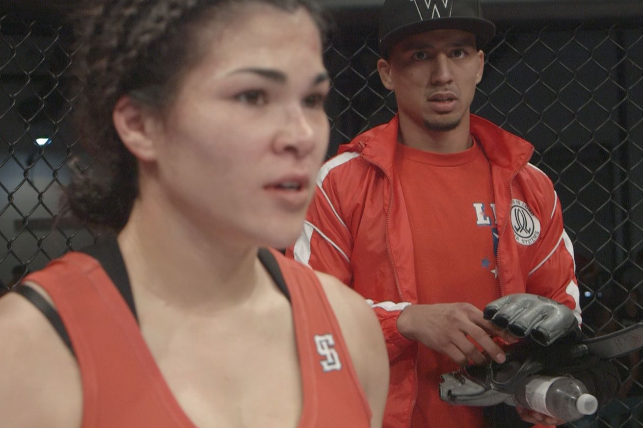 Arnold Berdon (right) standing by his wife, UFC fighter Rachael Ostovich