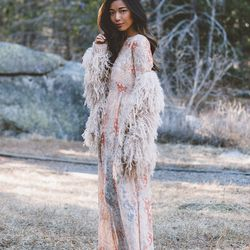 """Stephanie of <a href=""""http://www.honeynsilk.com""""target=""""_blank""""> Honey & Silk</a> is wearing a Free People dress and jacket and La Canadienne boots."""