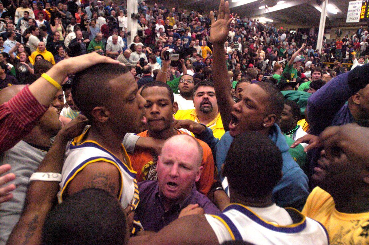 Waukegan fans surrounding Jereme Richmond after his half court buzzer-beater against Warren in the 2009 state playoffs.