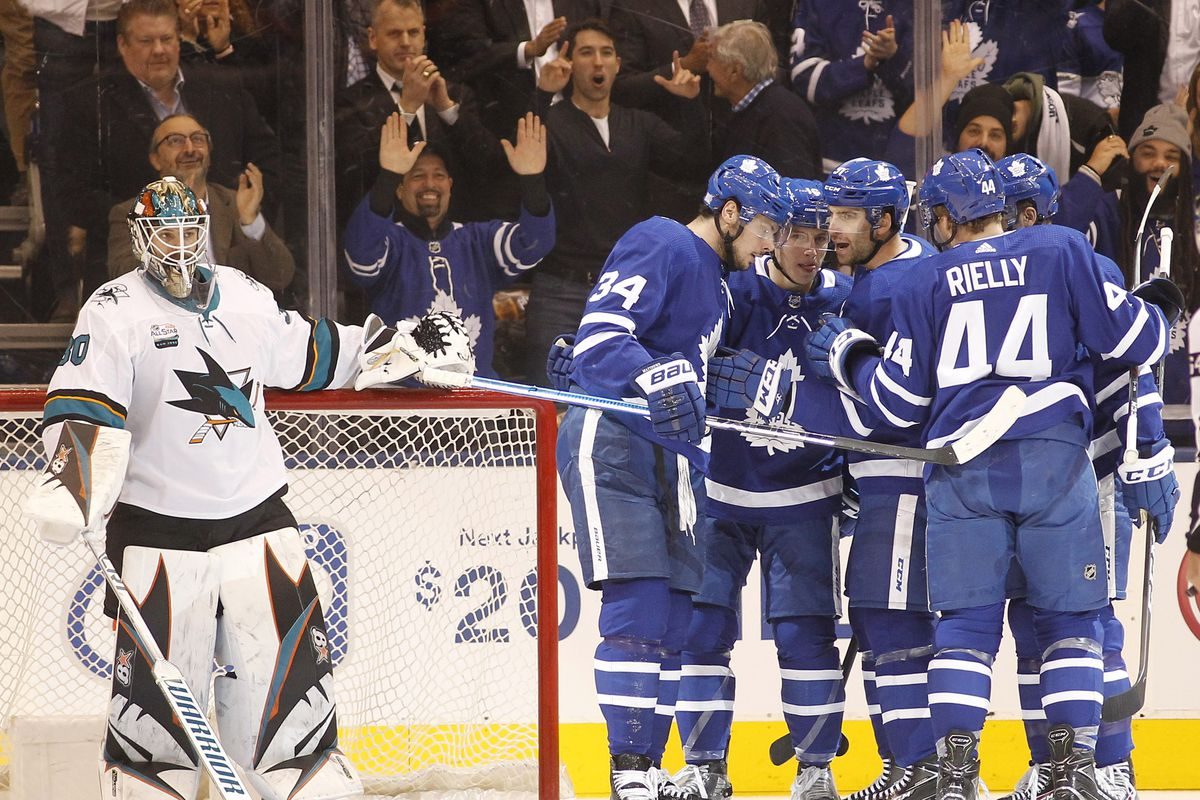 Nov 28, 2018; Toronto, Ontario, CAN; Toronto Maple Leafs forward John Tavares (cener of huddle) celebrates his first goal of the game against San Jose Sharks goaltender Aaron Dell (30) during the first period at Scotiabank Arena.