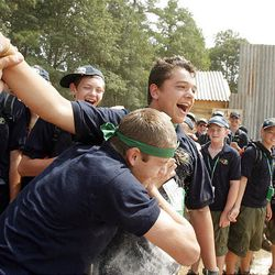 Nate Probst, left, celebrates a Buckaroo Bob inflatable horse race win with teammate Zach Nemelka -- both with the Utah National Parks Council -- at the National Scout Jamboree at Fort AP Hill in Virginia Tuesday.