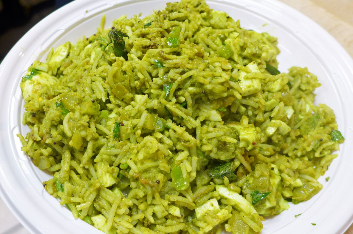 The egg biryani is very, very green.