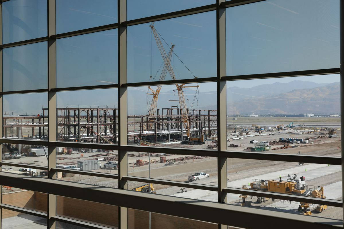 Construction on Phase 2 of the Salt Lake City International Airport is pictured through the windows of the completed portion of the facility on Wednesday, which marked the first anniversary of the opening of Phase 1 of the airport.