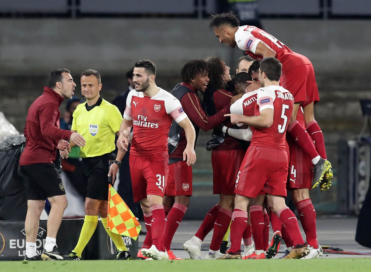 Arsenal's players celebrate a goal during the UEFA Europa...