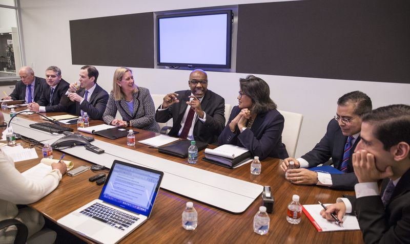 Democratic candidates for Illinois attorney general, from left, Pat Quinn, Aaron Goldstein, Scott Drury, Nancy Rotering, Kwame Raoul, Sharon Fairley, Jesse Ruiz and Renato Mariotti meet with the Sun-Times Editorial Board in 2018.