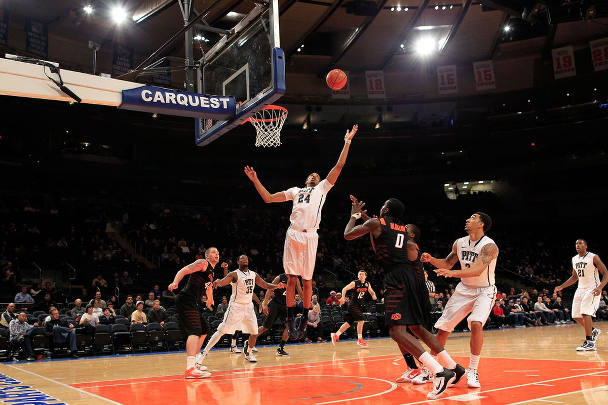NEW YORK, NY - DECEMBER 10: Khem Birch #24 of the Pittsburgh Panthers rebounds over Jean-Paul Olukemi #0 of the Oklahoma State Cowboys  at Madison Square Garden on December 10, 2011 in New York City.  (Photo by Chris Trotman/Getty Images)