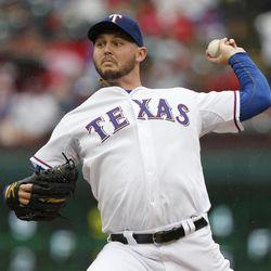 Texas Rangers starter Matt Harrison (54) throws to the Seattle Mariners in the first inning of a baseball game Sunday, Sep. 16, 2012, in Arlington, Texas.