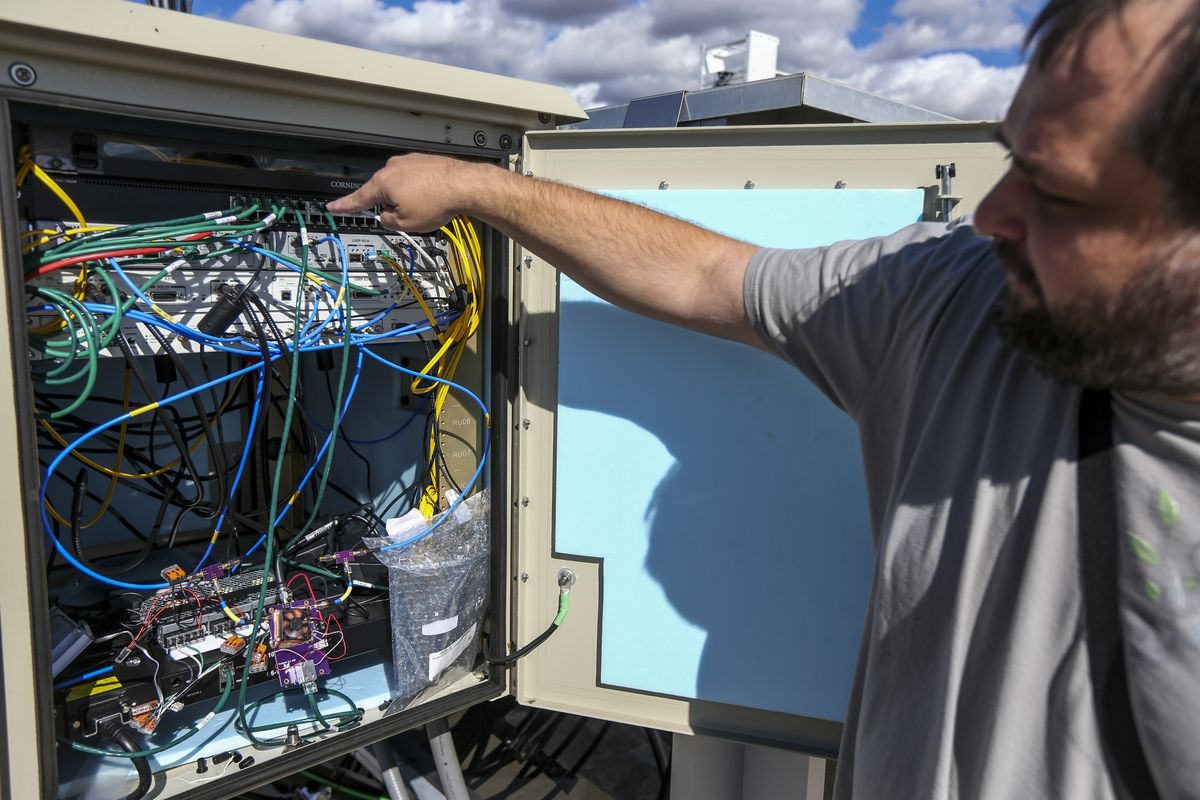 Jonathon Duerig points out the different parts of the software defined base station on the roof of the Merrill Engineering Building on the University of Utah campus in Salt Lake City on Friday, Oct. 18, 2019.
