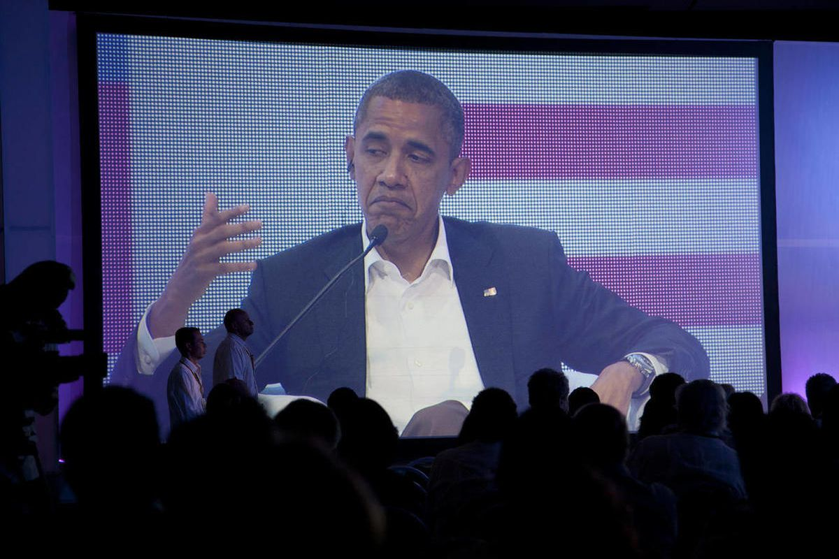 President Barack Obama is pictured on a large video screen during a three-way conversation with Brazil's President Dilma Rousseff and Colombia's President Juan Manuel Santos, not pictured, at the CEO Summit of the Americas in Cartagena, Colombia, Saturday