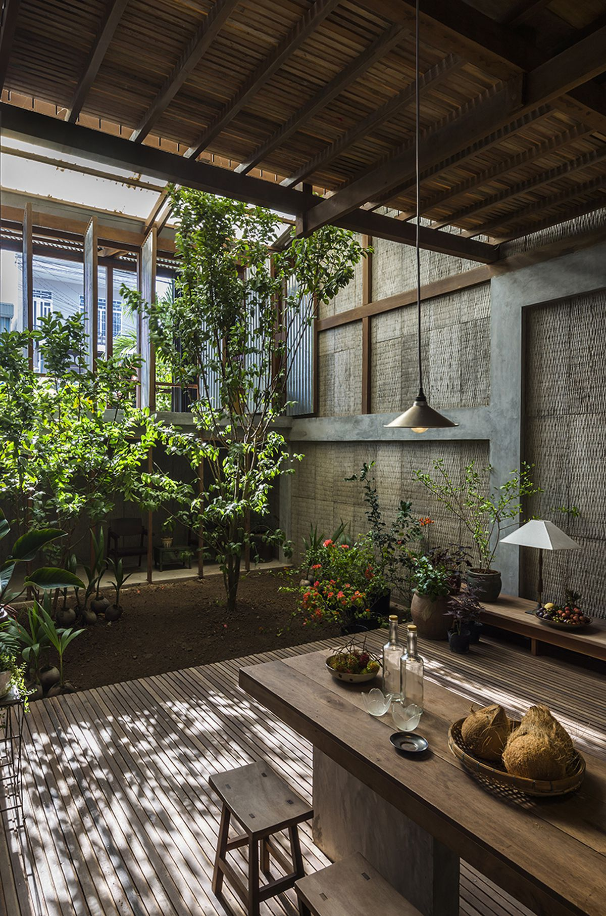 Rotating metal panels shelter open-air home in Vietnam - Curbed