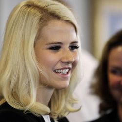Elizabeth Smart talks with attendees after speaking during The Family Support Center Blue Ribbon Breakfast in Salt Lake City  Wednesday, Sept. 14, 2011. The center assists child abuse prevention and treatment programs and homeless assistance.