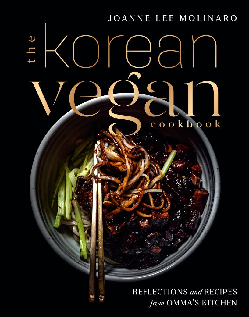 A black cookbook cover with a bowl of food and chopsticks