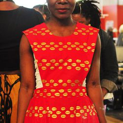 """<a href=""""https://www.etsy.com/ca/shop/DreamsOfFash/""""><b>Dream of Fash</b></a> uses traditional African fabrics to create chic, modern silhouettes. We loved the bright red dress with gold foil owner <b>Belkis Whyte</b> is wearing above. Her recent creation"""