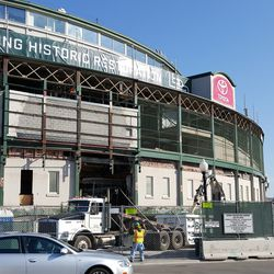 10:52 a.m. Wider view of main entrance demolition -