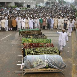 People get ready to offer funeral prayers of workers who lost their lives in a factory fire, Wednesday, Sept. 12, 2012 in Karachi, Pakistan. Pakistani officials say the death toll from devastating factory fires that broke out in two major cities has killed hundreds.