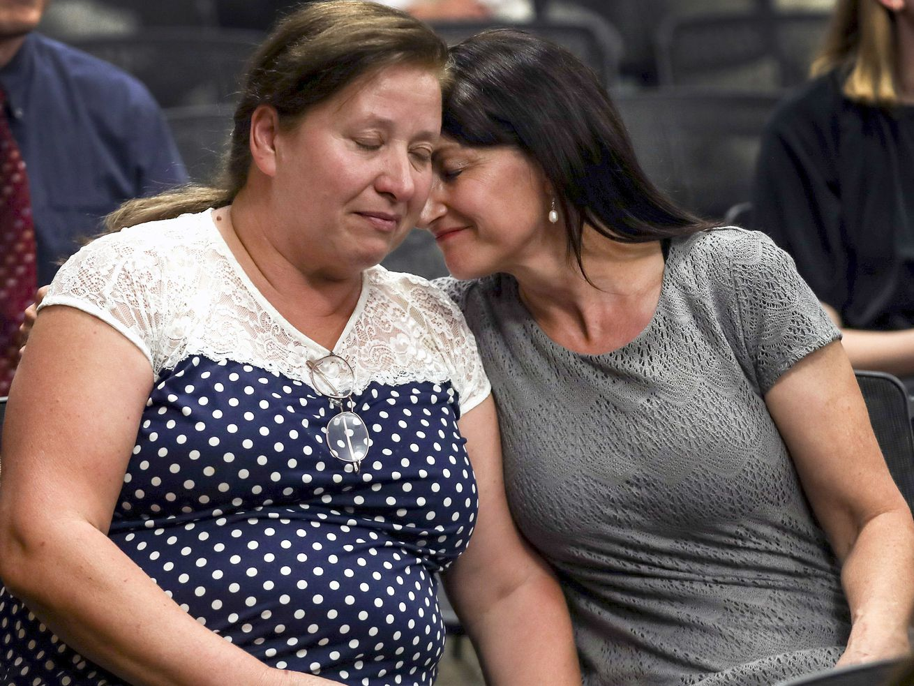 Maria Almiron, grandmother of 3-year-old Gabriel Almiron, left, and Brenda Marsh, mother of Emily Almiron, Gabriel's mother, embrace after speaking at a press conference at Orem City Hall on Wednesday, Aug. 7, 2019.