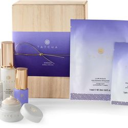 """Treat your jet-setting friend to the <b>Tatcha Complete Travel Ritual Set</b> to help shield her skin from the dry airplane air. At <b>$145</b> from <a href=""""http://www.tatcha.com/shop/p-kinhaku-gold-leaf-hospitality-set-gp"""">Tatcha</a>, this set contains"""