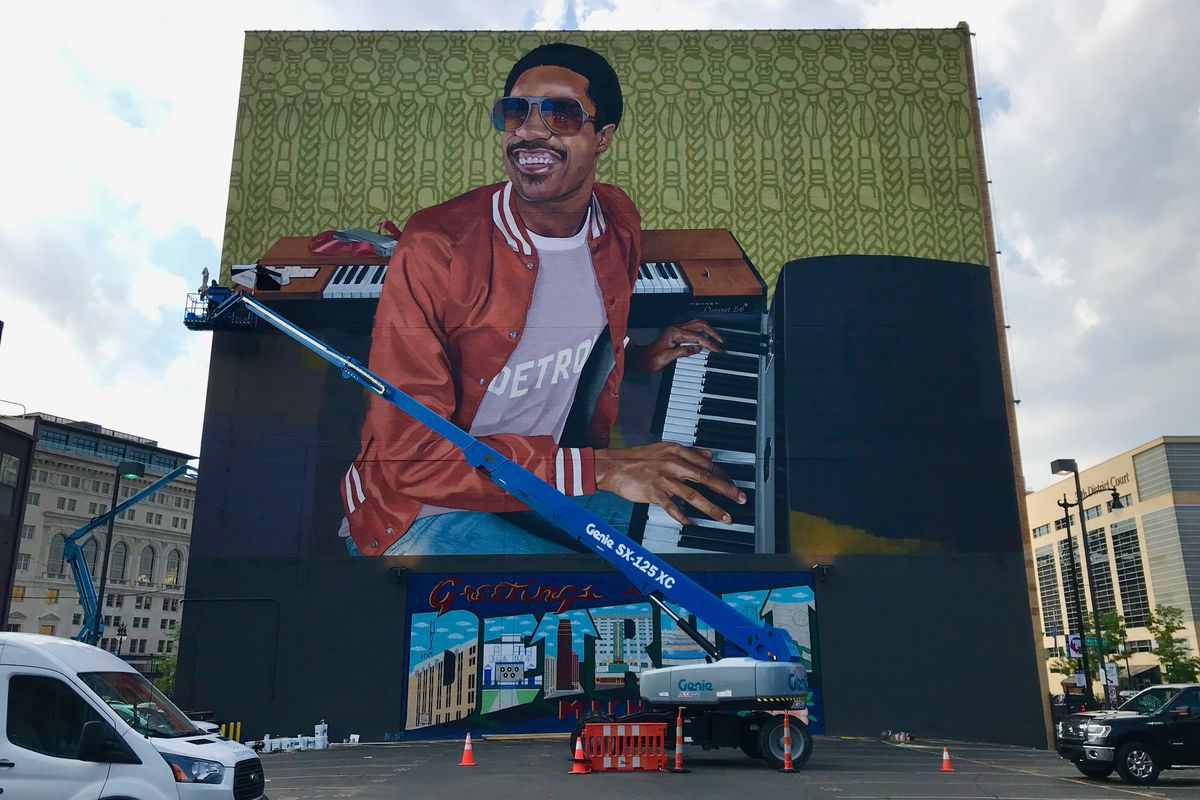The side of a building. There is a mural depicting Stevie Wonder on the side of the building.