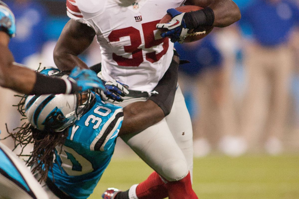 Sep 20, 2012; Charlotte, NC, USA New York Giants running back Andre Brown (35) runs with the ball against Carolina Panthers. Jeremy Brevard-US PRESSWIRE