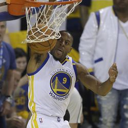 Golden State Warriors forward Andre Iguodala (9) dunks against the Cleveland Cavaliers during the first half of Game 1 of basketball's NBA Finals in Oakland, Calif., Thursday, June 1, 2017.