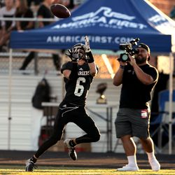 Corner Canyon's Talmage Handley reaches up for the ball on a long pass reception for a touchdown as Corner Canyon and Bingham play a high school football game at Corner Canyon on Friday, Aug. 30, 2019. Corner Canyon won 56-28.