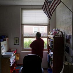 In this Thursday, April 5, 2012 photo, Gary Parkes, president of the PTA at Carmel Elementary School lowers the blinds in an empty classroom in Woodstock, Ga. By any measure, the PTA is one of the most venerable and iconic of America's volunteer-based nonprofits. But membership has dropped steadily over the past 10 years and for some parents, the PTA's advocacy work is cause for annoyance, rather than pride. Parkes said he and many other parents in the local organization would like to sever ties with the National PTA and become an independent parent-teacher organization, but had been told by the school district that this would not be allowed.