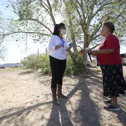 Sahar Khadjenoury, Utah Navajo COVID-19 Relief program project coordinator, chats with Marie Yazzie after delivering food and masks to her in Aneth, San Juan County, on Friday, May 1, 2020. TheNavajo Nation has one of the highest per capita COVID-19 infection rates in the country.