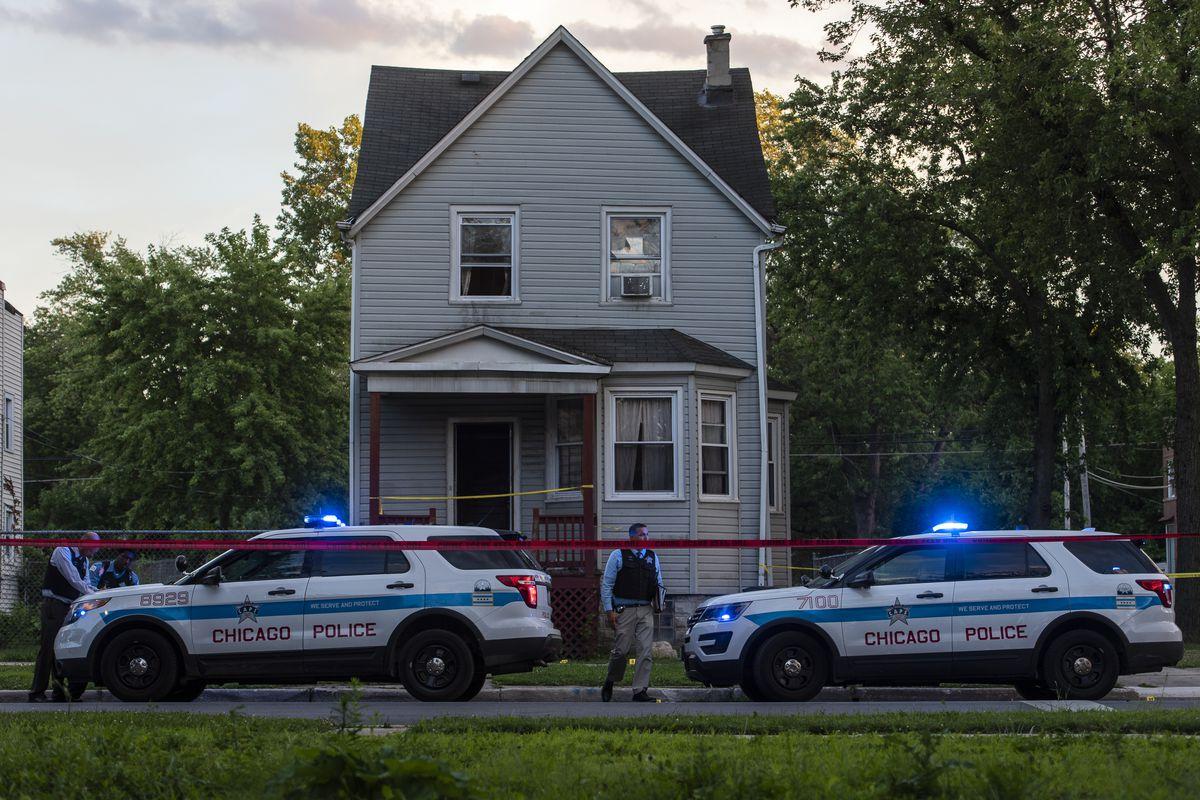 Chicago police investigate the scene where five people were shot July 27, 2020, in Burnside.